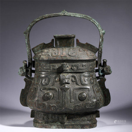 A CHINESE CARVED BRONZE RITUAL WINE VESSEL