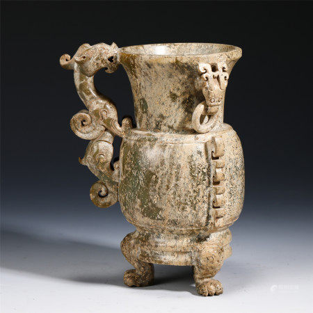 A CHINESE CARVED JADE VASE WITH DRAGON HANDLE