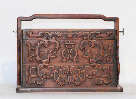 A CHINESE CARVED HARDWOOD BOX WITH HANDLE