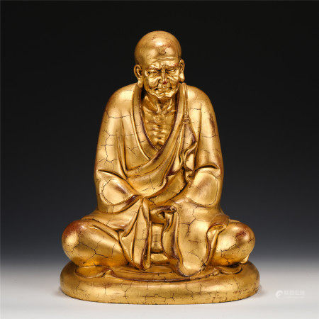 A CHINESE GOLD PAINTED HARDWOOD FIGURE OF BUDDHA