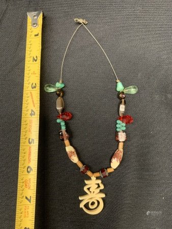 Necklace with Bone Carving