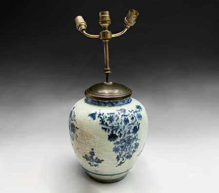 A Chinese blue and white porcelain baluster vase, 17th century, the body with floral sprays,