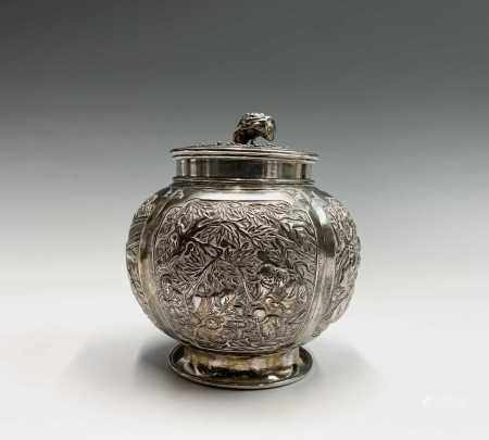 A Chinese silver globular tea caddy, the body with four shaped panels enclosing garden scenes