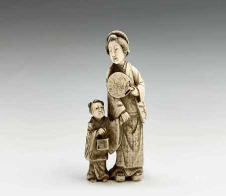 A Chinese carved ivory group of a mother and child, 19th century, character marks on rear, height