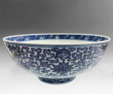 A large Chinese blue and white porcelain Ming-style bowl, 18th century, with Qianlong seal mark