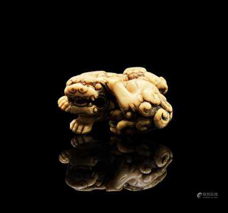 A Japanese ivory netsuke, 18th century, Kyoto school, unsigned but attributed to Tomotada, depicting