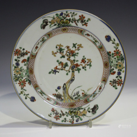A Chinese famille verte porcelain plate, Kangxi period, the centre painted and gilt with a
