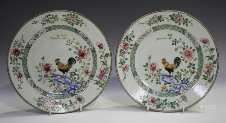 A pair of Chinese famille rose export porcelain plates, Yongzheng period, each centre finely painted