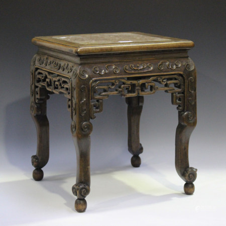 A Chinese hardwood jardinière stand, late 19th century, the square top inset with a rouge marble
