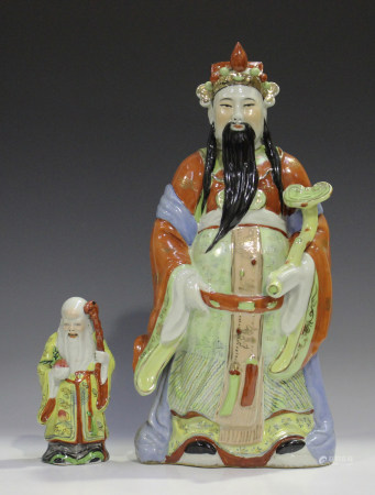 A Chinese porcelain figure of an immortal, mid-20th century, modelled standing wearing a long robe