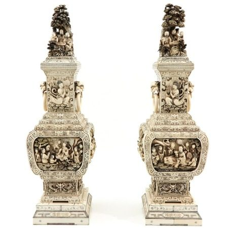 A Pair of Carved Vases with Covers