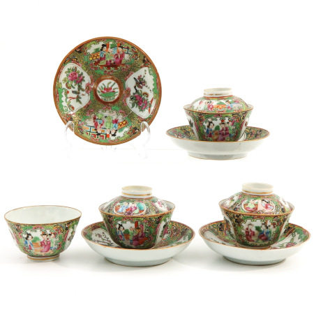 A Collection of Covered Cups and Saucers