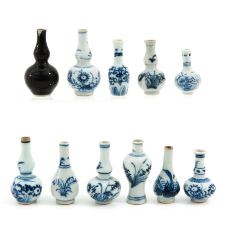 A Collection of 11 Miniature Vases