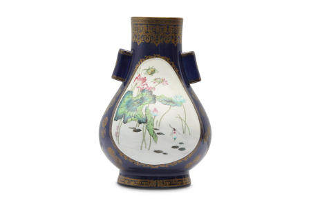A CHINESE FAMILLE ROSE POWDER-BLUE GROUND ARROW VASE.
