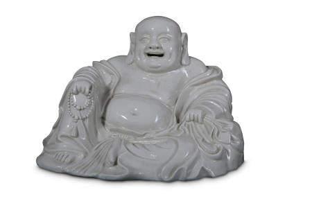 A CHINESE BLANC-DE-CHINE FIGURE OF BUDAI HESHANG.