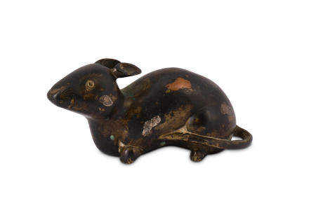 A CHINESE COPPER AND SILVER-SPLASHED BRONZE 'RAT' PAPERWEIGHT.