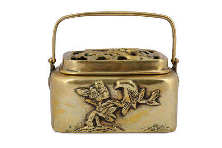 † A RECTANGULAR-SECTION BRONZE HAND WARMER AND COVER.