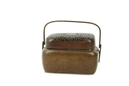 A CHINESE BRONZE HAND WARMER AND COVER.