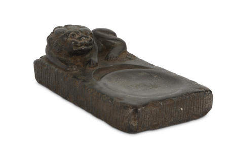 A CHINESE STONE 'LION DOG' INK STONE.