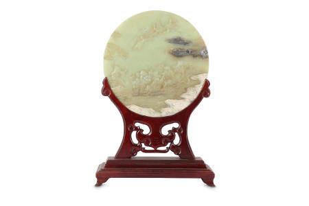 A CHINESE PALE CELADON JADE CIRCULAR 'IMMORTALS' TABLE SCREEN.