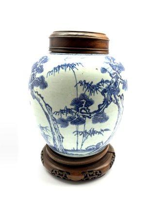 18th century Chinese Provincial blue and white ginger jar decorated with tree and sprays of bamboo a
