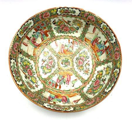 19th century Cantonese porcelain punch bowl, painted in famille rose enamels with panels of figures