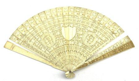19th century Chinese Canton carved ivory brise fan: each pierced stick intricately carved on one sid