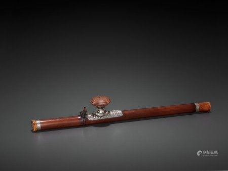 A BAMBOO OPIUM PIPE WITH CERAMIC AND SILVER FITTINGS