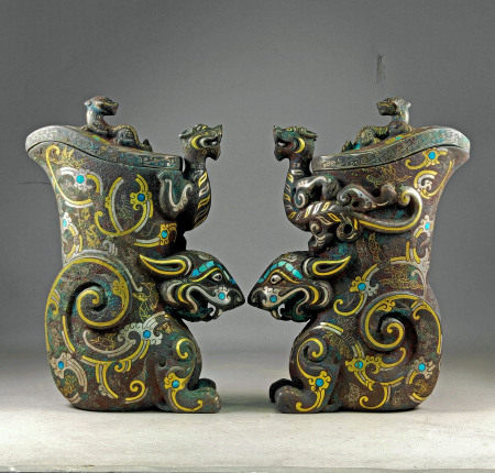 A PAIR OF BEONZE CUPS WITH GOLD INLAY