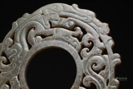 漢代 白玉帶沁透雕蟠龍環