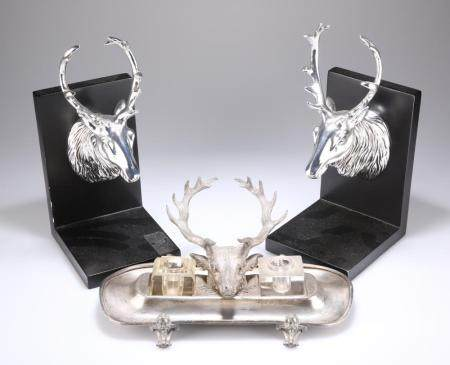 A BRITANNIA METAL DESK INKSTAND WITH STAG'S HEAD FEATURE, two inkwells and