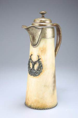 A HORN BODIED CLARET JUG, with silver-plated mounts and bearing the badge o