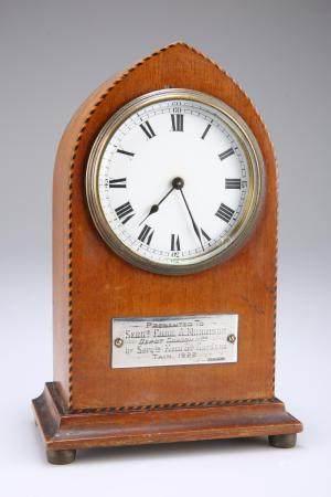 A PRESENTATION MAHOGANY VENEERED MANTEL CLOCK, with chequered boxwood strin