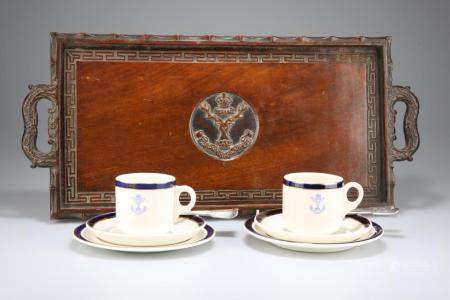 A FINELY CARVED RECTANGULAR WOODEN SERVING TRAY FEATURING THE BADGE OF THE