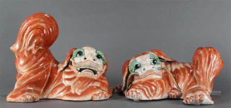 A pair Chinese iron red porcelain fu dogs