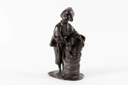 Bronze sculpture depicting a young farmer with basket, Japan Meiji period