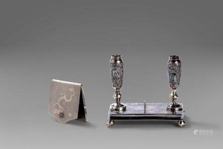 Lot consisting of a silver pen holder signed Wang Hing and a silver match holder, 20th century China