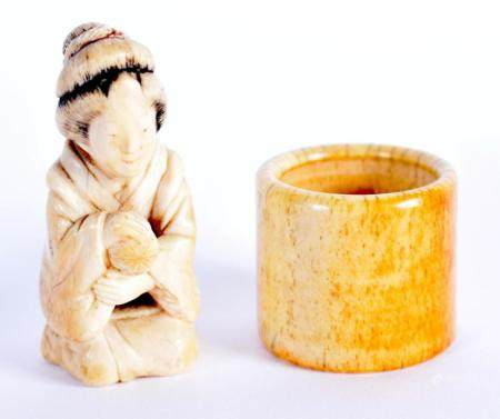 A 19TH CENTURY JAPANESE MEIJI PERIOD CARVED IVORY OKIMONO together with a Chinese bone archers ring. Largest 5.5 cm x 2.5 cm. (2)