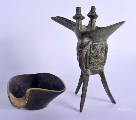 A CHINESE BRONZE JUE BRONZE WINE VESSEL 20th Century, together with a bronze brush washer. Largest 15 cm x 8 cm. (2)