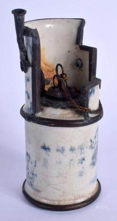 AN UNUSUAL EARLY 20TH CENTURY CHINESE BLUE AND WHITE OPIUM PIPE Late Qing, bearing Yongzheng marks to base. 14 cm high.