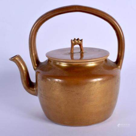 A RARE 18TH/19TH CENTURY CHINESE CAFE AU LAIT PORCELAIN TEAPOT AND COVER Qing, of plain form. 15 cm wide.