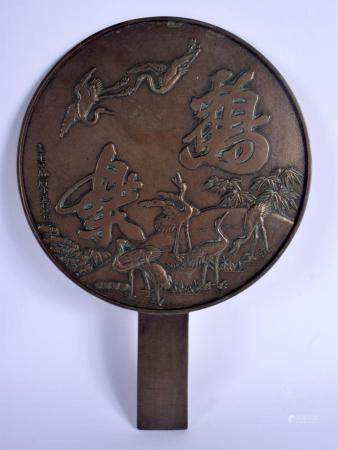 A 19TH CENTURY JAPANESE MEIJI PERIOD BRONZE HAND MIRROR decorated with birds and landscapes. 33 cm x 23 cm.