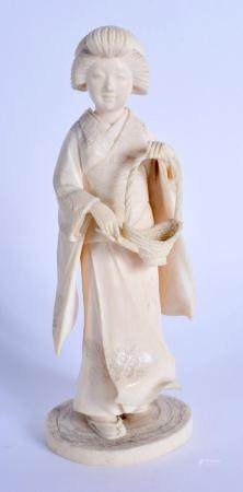 A 19TH CENTURY JAPANESE MEIJI PERIOD CARVED IVORY FIGURE OF A GEISHA modelled holding a basket. 17 cm high.