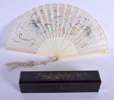 A 19TH CENTURY CHINESE EXPORT CANTON IVORY FAN Qing, decorated with a silk dragon. 35 cm wide extended.
