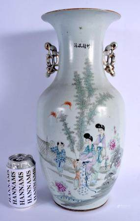 A LARGE CHINESE REPUBLICAN PERIOD FAMILLE ROSE PORCELAIN VASE painted with figures and landscapes. 42 cm high.