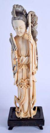 A LATE 19TH CENTURY CHINESE CARVED IVORY IMMORTAL Qing, modelled holding a bamboo pole. Ivory 18.5 cm high.