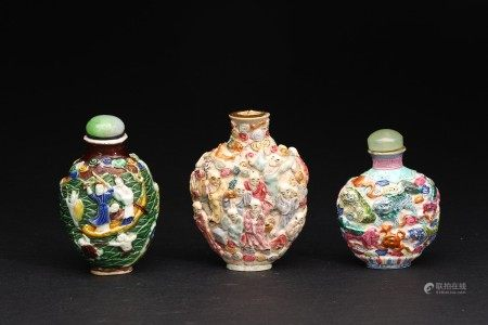 A GROUP OF THREE CARVED FAMILLE ROSE SNUFF BOTTLES