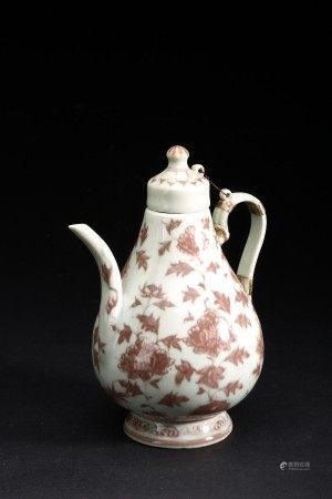 AN UNDERGLAZED 'FLOWERS' RED TEAPOT