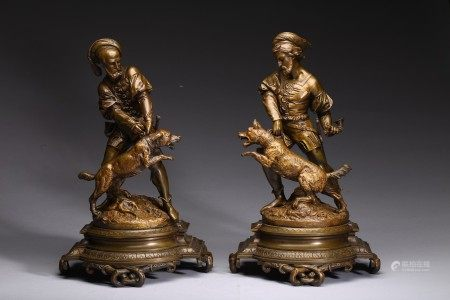 A PAIR OF FRENCH BRONZE FIGURAL GROUP OF HUNTSMEN AND DOGS