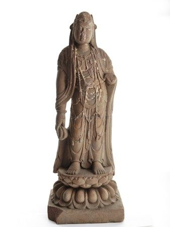 A STONE CARVING OF STANDING BODHISATTVA